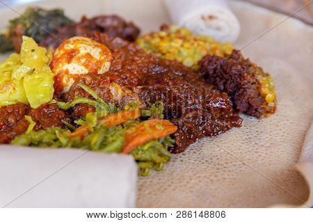 Injera Served With Chicken And