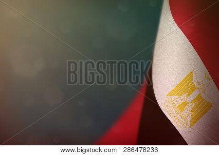 poster of Egypt Hanging Flag For Honour Of Veterans Day Or Memorial Day On Light Blue Dark Velvet Background.