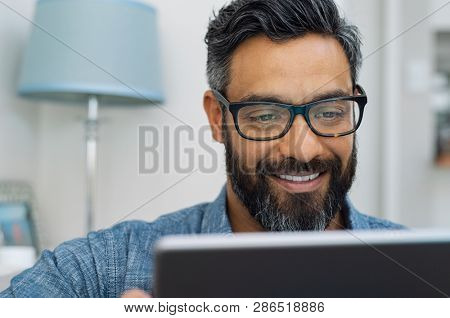 Relaxed mature man at home