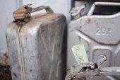 Metal Barrel And Ukrainian Money, The Concept Of The Cost Of Gasoline, Diesel, Gas. Refilling The Ca poster