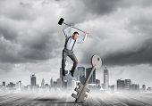 Determined Businessman Against Cityscape Breaking With Hammer Stone Key Figure poster