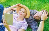 Man And Girl Lay On Grass Reading Book. Family Enjoy Leisure With Poetry Or Literature Book Grass Ba poster