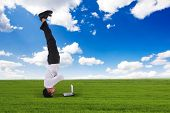 Businessman Headstand Outdoors