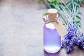 Aromatherapy Oil And Lavender, Lavender Spa, Wellness With Lavender, Lavender Syrup On A Wooden Back poster