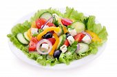 stock photo of greek  - Greek salad isolated on white with feta cheese and vegetables - JPG