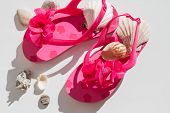Fashionable Sandals, Seashells On White Background, Top View, Flat Lay.summer Pink Shoes For Kids, C poster