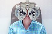 Man Ophthalmologist Examining Patient Man With Optometrist Trial Frame. Male Patient To Check Vision poster