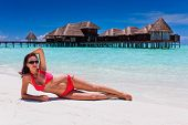 Woman in red bikini in tropical beach destination poster