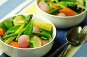 foto of mange-toute  - colorful, fresh, cooked, mixed vegetables with asparagus, zucchini, carrots and baby corn