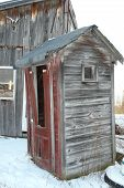 image of olden days  - An old outhouse at our home that is no longer used - JPG