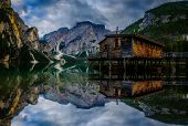 Majestic water reflection of Lago Braies, , Dolomites mountain lake in sunrise light scenery in East poster