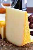 Pieces Of French Yellow Cheeses, Pur Brebis Sheep Melk Cheese Fron Pyrenees And Saint Paulin Creamy, poster