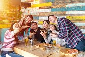 Cheerful Young Friends Taking Selfie With Smart Phone While Sharing A Pizza - Young People At Table  poster