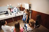 Professional Makeup Teacher Training Her Student Girl To Become Makeup Artist. Makeup Tutorial Lesso poster