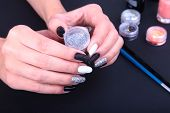 Black, White Nail Art Manicure. Holiday Style Bright Manicure With Sparkles. Bottle Of Nail Polish.  poster