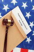 Divorce decree and envelope on american flag background