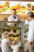 Grandchildren asking grandmother for cakes at cafe dessert appetite restaurant