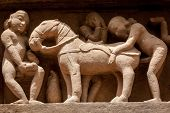 Famous erotic stone carving bas relieves, Lakshmana Temple, Khajuraho, India. Unesco World Heritage