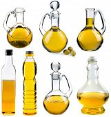 Olive and sunflower oil in the bottles and decanters isolated on white  background