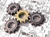 Pinion gear close-up on a blueprints background