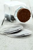 Close up of two teabags on wooden table