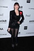 LOS ANGELES - OCT 11:  Rose McGowan arrives at the amfAR Inspiration Gala Los Angeles at Milk Studio