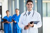 picture of coat tie  - young medical doctor and staff in hospital - JPG