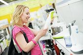 foto of blender  - Young woman choosing kitchen mixer blender in home appliance shopping mall supermarket - JPG