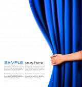 stock photo of cinema auditorium  - Background with blue velvet curtain and hand - JPG