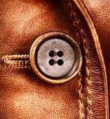 Leather and Button background. Genuine Leather Jacket Detail closeup
