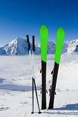 Skiing, winter season , mountains and ski equipment in the snow
