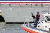 NEW YORK - OCT 6: Armed Coast Guard patrol guards the USS Michael Murphy (DDG 112) docked at Pier 88