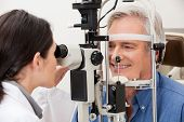 stock photo of peripherals  - Optometrist performing visual field test - JPG