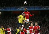 LONDON, ENGLAND. 31/03/2010. Barcelona player Seydou Keita and Arsenal player William Gallas during