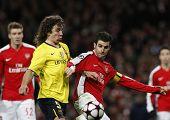 LONDON, ENGLAND. 31/03/2010. Barcelona's Carles Puyol fouls Arsenal'sCesc Fa?bregas to concede a pen