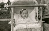 Vintage photo of baby girl in a stroller, fifties