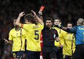LONDON, ENGLAND. 31/03/2010. Barcelona player Carles Puyol (captain) is shown the red card  during the  UEFA Champions League quarter-final between Arsenal and Barcelona at the Emirates Stadium