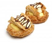 Choux pastry buns filled with fresh cream and custard.