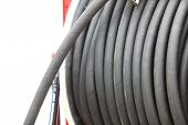 Rolled Up Of Gray Rubber Hose