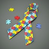 pic of autism  - A 3d rendered autism awareness ribbon with colored puzzle pieces. 