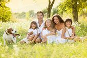 stock photo of father time  - Happy young family spending time outdoor on a summer day - JPG