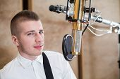 Man in room with microphone in Recording Studio