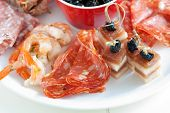 stock photo of crudites  - Delicious plate with antipasti snacks such as chorizo and shrimps - JPG