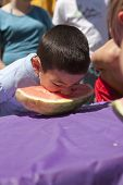 Boy Digs In To Watermelon.