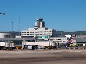 Air Traffice Control Tower At Sfo Airport With Plane At Gate