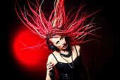 stock photo of dreadlocks  - Expressive girl rock singer with great red dreadlocks - JPG