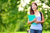stock photo of fall day  - Student girl outdoor in park smiling happy going back to school - JPG