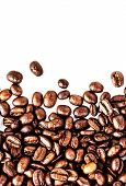 Closeup Of Roasted Coffee Beans  Heap. Coffee Beans Background Texture Isolated On White Background
