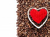Roasted Coffee Beans With Red Heart Over Coffee Beans Background Isolated On White  With Copy Space.