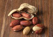 image of testis  - Peeled peanuts on well peanuts in background - JPG